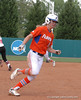 Kasey Fagan rounds 3rd Base and continues to score the Gators 5th run of the game