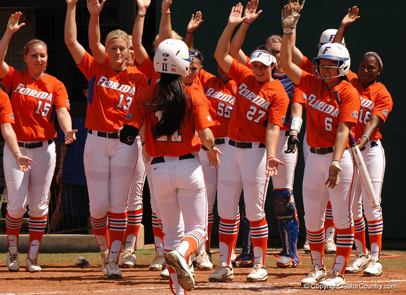 """Ensley Gammel's teammates celebrate the 3rd Homerun of the 4th Inning with another """"Homerun Chomp"""""""