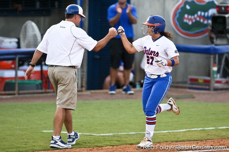 Florida head coach Tim Walton congradulates freshman shortstop Cheyenne Coyle on her solo homerun in the bottom of the fifth inning during the Gators' 8-0 win against the Bethune-Cookman Wildcats on Friday, May 20, 2011 at Katie Seashole Pressly Stadium in Gainesville, Fla. / photo by Rob Foldy