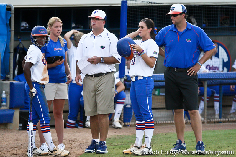 Florida head coach Tim Walton taks with junior center fielder Michelle Moultrie and sophomore Ensley Gammel during a Bethune-Cookman pitching change in the Gators' 8-0 win against the Wildcats on Friday, May 20, 2011 at Katie Seashole Pressly Stadium in Gainesville, Fla. / photo by Rob Foldy