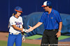 Florida senior first baseman Megan Bush and volunteer coach Coy Adkins slap hands during the Gators' 8-0 win against the Bethune-Cookman Wildcats on Friday, May 20, 2011 at Katie Seashole Pressly Stadium in Gainesville, Fla. / photo by Rob Foldy