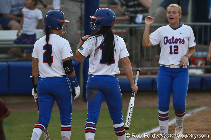 Florida senior Kelsey Bruder and sophomore Ensley Gammel return to the dugout after the Gators' 8-0 win against the Bethune-Cookman Wildcats on Friday, May 20, 2011 at Katie Seashole Pressly Stadium in Gainesville, Fla. / photo by Rob Foldy