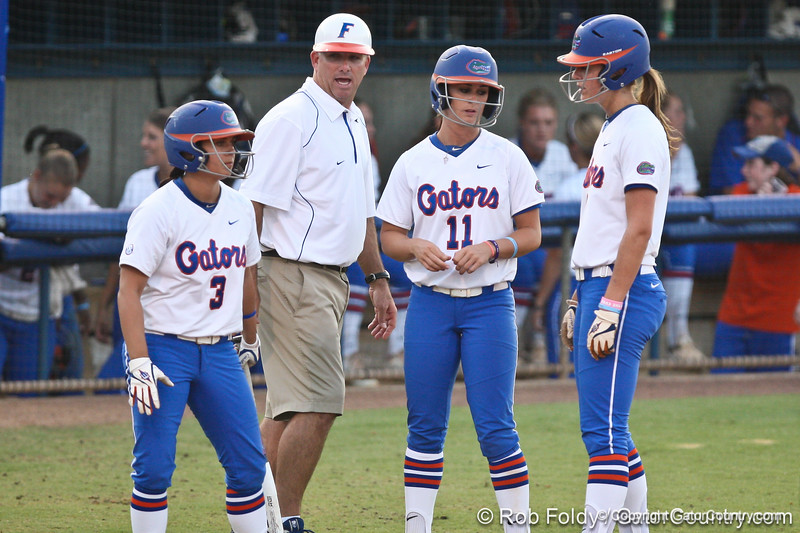 Florida head coach Tim Walton talks with senior Aja Paculba, sophomore Ensley Gammel, and freshman Kasey Fagan during a Bethune-Cookman pitching change in the Gators' 8-0 win against the Wildcats on Friday, May 20, 2011 at Katie Seashole Pressly Stadium in Gainesville, Fla. / photo by Rob Foldy