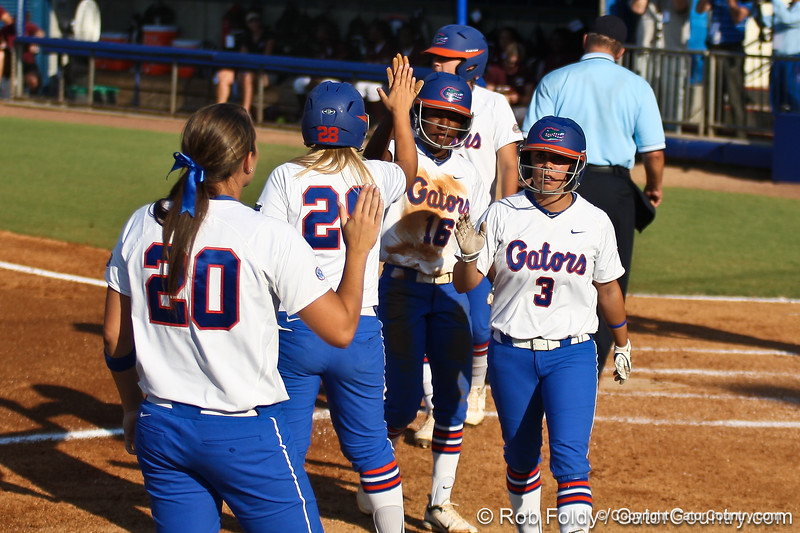 Florida senior second baseman Aja Paculba and junior center fielder Michelle Moultrie are welcomed by their teammates after scoring during the Gators' 8-0 win against the Bethune-Cookman Wildcats on Friday, May 20, 2011 at Katie Seashole Pressly Stadium in Gainesville, Fla. / photo by Rob Foldy