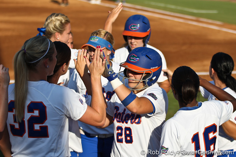 Florida senior catcher Tiffany DeFelice gets high-fives from her teammates during the Gators' 8-0 win against the Bethune-Cookman Wildcats on Friday, May 20, 2011 at Katie Seashole Pressly Stadium in Gainesville, Fla. / photo by Rob Foldy