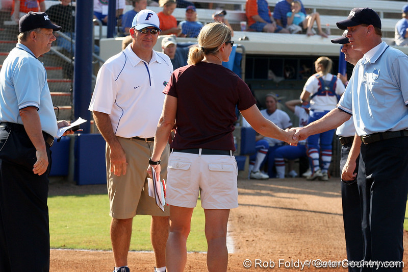 Florida head coach Tim Walton and the Wildcat's head coach Chris Cochran meet with the umpires before the Gators' 8-0 win against Bethune-Cookman on Friday, May 20, 2011 at Katie Seashole Pressly Stadium in Gainesville, Fla. / photo by Rob Foldy