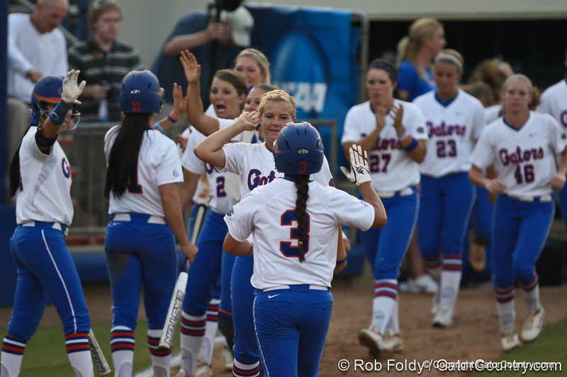 Florida players high-five after the Gators' 8-0 win against the Bethune-Cookman Wildcats on Friday, May 20, 2011 at Katie Seashole Pressly Stadium in Gainesville, Fla. / photo by Rob Foldy
