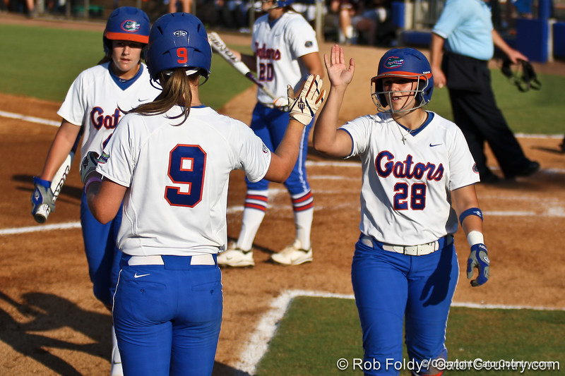 Florida senior catcher Tiffany DeFelice high-fives teammate Kasey Fagan during the Gators' 8-0 win against the Bethune-Cookman Wildcats on Friday, May 20, 2011 at Katie Seashole Pressly Stadium in Gainesville, Fla. / photo by Rob Foldy