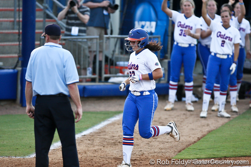 Florida freshman shortstop Cheyenne Coyle tags home plate after her solo homerun in the bottom of the fifth inning during the Gators' 8-0 win against the Bethune-Cookman Wildcats on Friday, May 20, 2011 at Katie Seashole Pressly Stadium in Gainesville, Fla. / photo by Rob Foldy