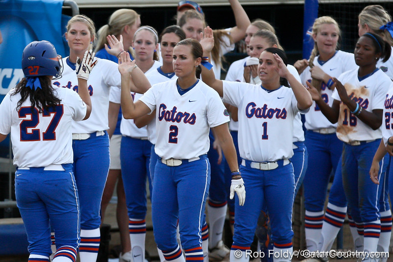 Florida freshman shortstop Cheyenne Coyle high-fives her teammates after her solo homerun in the bottom of the fifth inning during the Gators' 8-0 win against the Bethune-Cookman Wildcats on Friday, May 20, 2011 at Katie Seashole Pressly Stadium in Gainesville, Fla. / photo by Rob Foldy