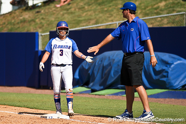 Florida senior second baseman Aja Paculba slaps hands with volunteer coach Coy Adkins on a hard-hit single during the Gators' 7-2 victory over the Tennessee Vols on Sunday, May 8, 2011 at Katie Seashole Pressly Stadium in Gainesville, Fla. / photo by Rob Foldy