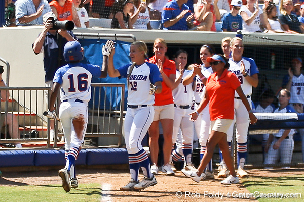 Florida junior center fielder Michelle Moultrie gets congratulated by her teammates during the Gators' 7-2 victory over the Tennessee Vols on Sunday, May 8, 2011 at Katie Seashole Pressly Stadium in Gainesville, Fla. / photo by Rob Foldy