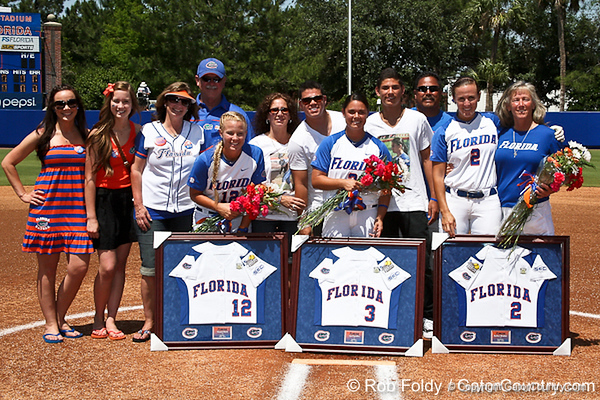 Florida seniors Megan Bush, Aja Paculba, Kelsey Bruder and their families prior to the Gators' 7-2 victory over the Tennessee Vols on Sunday, May 8, 2011 at Katie Seashole Pressly Stadium in Gainesville, Fla. / photo by Rob Foldy