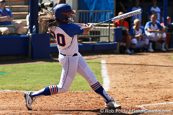 Florida sophomore Kelsey Horton follows through after a solo homer during the 5th inning of the Gators' 7-2 victory over the Tennessee Vols on Sunday, May 8, 2011 at Katie Seashole Pressly Stadium in Gainesville, Fla. / photo by Rob Foldy