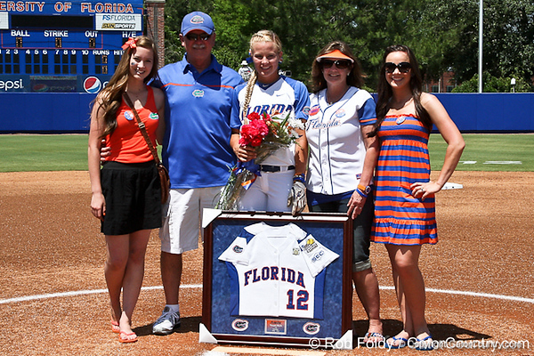 Florida senior first baseman Megan Bush poses for a photo with her family before the Gators' 7-2 victory over the Tennessee Vols on Sunday, May 8, 2011 at Katie Seashole Pressly Stadium in Gainesville, Fla. / photo by Rob Foldy