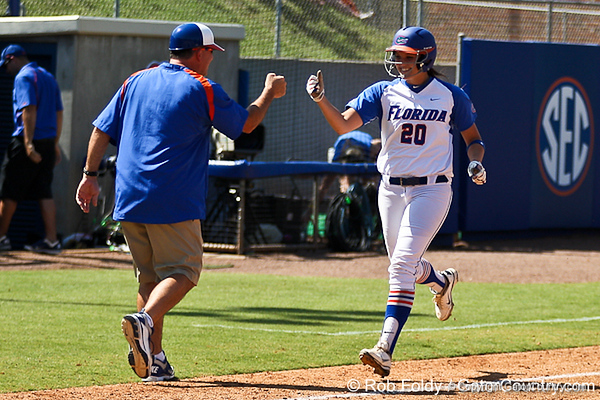 Florida head coach Tim Walton congratulates sophomore Kelsey Horton on her solo home run during the Gators 7-2 victory over the Tennessee Vols on Sunday, May 8, 2011 at Katie Seashole Pressly Stadium in Gainesville, Fla. / photo by Rob Foldy