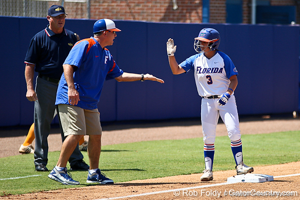 Florida head coach Tim Walton congratulates senior second baseman Aja Paculba on her stand-up triple in the first inning of the Gators' 7-2 victory over the Tennessee Vols on Sunday, May 8, 2011 at Katie Seashole Pressly Stadium in Gainesville, Fla. / photo by Rob Foldy
