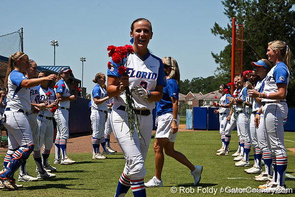 Florida senior Kelsey Bruder receives flowers from her teammates before the Gators' 7-2 victory over the Tennessee Vols on Sunday, May 8, 2011 at Katie Seashole Pressly Stadium in Gainesville, Fla. / photo by Rob Foldy