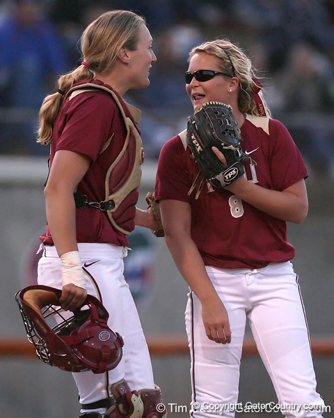 photo by Tim Casey<br /> <br /> FSU catcher Kaleigh Rafter talks with pitcher Terese Gober during the seventh inning of the Gators' 4-3 win in nine innings against the Florida State Seminoles on Wednesday, April 8, 2009 at Katie Seashole Pressly Softball Stadium in Gainesville, Fla.