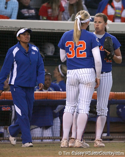 photo by Tim Casey<br /> <br /> Florida sophomore pitcher Stephanie Brombacher talks with senior pitcher Stacey Nelson during the eighth inning of the Gators' 4-3 win in nine innings against the Florida State Seminoles on Wednesday, April 8, 2009 at Katie Seashole Pressly Softball Stadium in Gainesville, Fla.