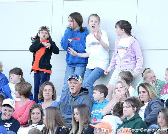 photo by Tim Casey<br /> <br /> Florida fans dance during the Gators' 4-3 win in nine innings against the Florida State Seminoles on Wednesday, April 8, 2009 at Katie Seashole Pressly Softball Stadium in Gainesville, Fla.