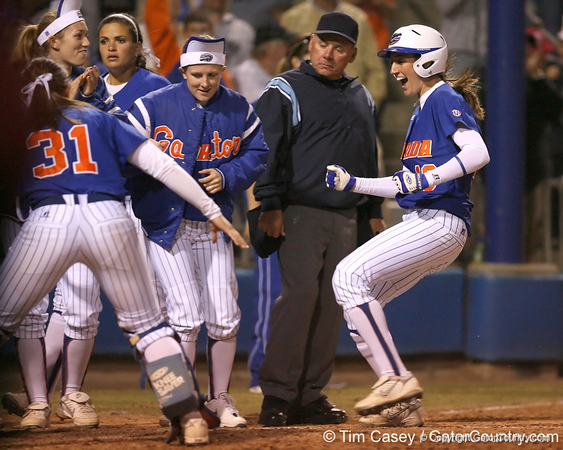 photo by Tim Casey<br /> <br /> Florida junior left fielder Francesca Enea scores after hitting a walk-off home run during the ninth inning of the Gators' 4-3 win against the Florida State Seminoles on Wednesday, April 8, 2009 at Katie Seashole Pressly Softball Stadium in Gainesville, Fla.