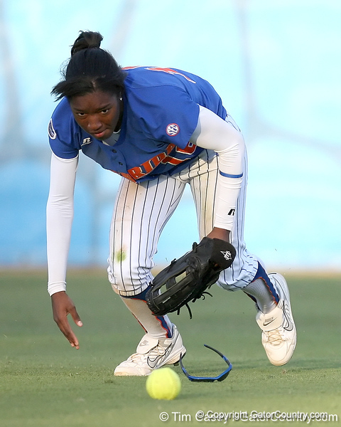 photo by Tim Casey<br /> <br /> Florida freshman Michelle Moultrie picks up a ball during the sixth inning of the Gators' 4-3 win in nine innings against the Florida State Seminoles on Wednesday, April 8, 2009 at Katie Seashole Pressly Softball Stadium in Gainesville, Fla.