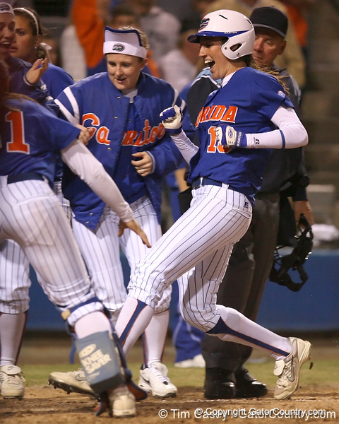 photo by Tim Casey<br /> <br /> Florida junior left fielder Francesca Enea crosses home plate after hitting a walk-off home run during the Gators' 4-3 win in nine innings against the Florida State Seminoles on Wednesday, April 8, 2009 at Katie Seashole Pressly Softball Stadium in Gainesville, Fla.