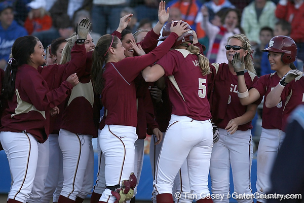 photo by Tim Casey<br /> <br /> FSU's Kalegh Rafter gets mobbed by teammates after hitting a two-run homer during the sixth inning of the Gators' 4-3 win in nine innings against the Florida State Seminoles on Wednesday, April 8, 2009 at Katie Seashole Pressly Softball Stadium in Gainesville, Fla.