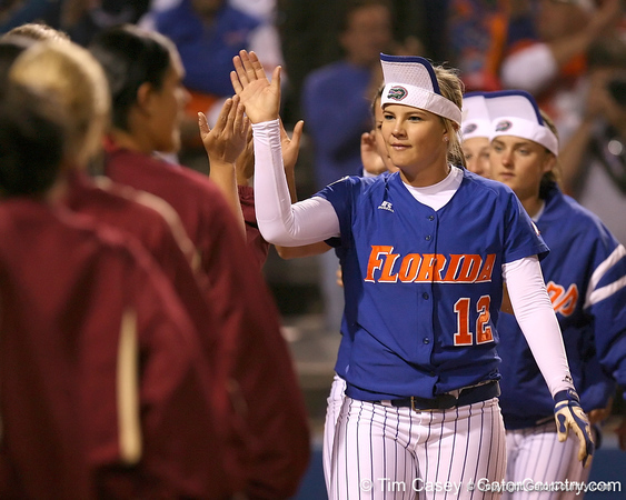 photo by Tim Casey<br /> <br /> Florida sophomore shortstop Megan Bush slaps hands with FSU players the Gators' 4-3 win in nine innings against the Seminoles on Wednesday, April 8, 2009 at Katie Seashole Pressly Softball Stadium in Gainesville, Fla.