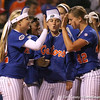 photo by Tim Casey<br /> <br /> Florida sophomore shortstop Megan Bush slaps hands with senior pitcher Stacey Nelson after the Gators' 4-3 win in nine innings against the Florida State Seminoles on Wednesday, April 8, 2009 at Katie Seashole Pressly Softball Stadium in Gainesville, Fla.