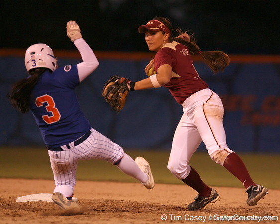 photo by Tim Casey<br /> <br /> Florida sophomore second baseman Aja Paculba is out at second base as FSU's Ashley Stager attempts to turn a double play during the Gators' 4-3 win in nine innings against the Florida State Seminoles on Wednesday, April 8, 2009 at Katie Seashole Pressly Softball Stadium in Gainesville, Fla.