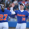 photo by Tim Casey<br /> <br /> Florida sophomore pitcher Stephanie Brombacher slaps hands with Corrie Brooks during the Gators' 4-3 win in nine innings against the Florida State Seminoles on Wednesday, April 8, 2009 at Katie Seashole Pressly Softball Stadium in Gainesville, Fla.