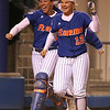 photo by Tim Casey<br /> <br /> Florida senior catcher Kristina Hilberth and sophomore shortstop Megan Bush run to home plate during the Gators' 4-3 win in nine innings against the Florida State Seminoles on Wednesday, April 8, 2009 at Katie Seashole Pressly Softball Stadium in Gainesville, Fla.
