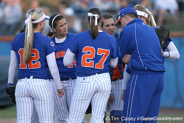 photo by Tim Casey<br /> <br /> Florida head coach Tim Walton talks with the infielders during the sixth inning of the Gators' 4-3 win in nine innings against the Florida State Seminoles on Wednesday, April 8, 2009 at Katie Seashole Pressly Softball Stadium in Gainesville, Fla.