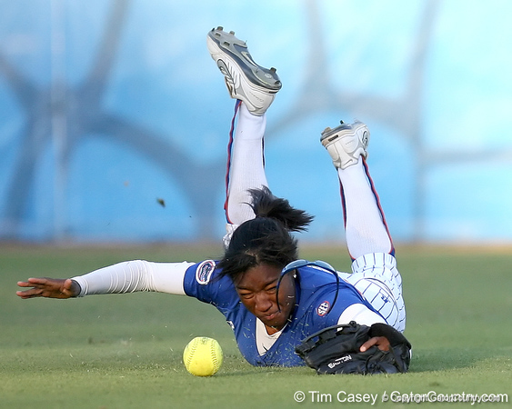photo by Tim Casey<br /> <br /> Florida freshman Michelle Moultrie dives for a ball during the sixth inning of the Gators' 4-3 win in nine innings against the Florida State Seminoles on Wednesday, April 8, 2009 at Katie Seashole Pressly Softball Stadium in Gainesville, Fla.
