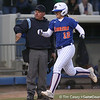 photo by Tim Casey<br /> <br /> Florida sophomore shortstop Megan Bush scores on a game-tying home run with two outs during the seventh inning of the Gators' 4-3 win in nine innings against the Florida State Seminoles on Wednesday, April 8, 2009 at Katie Seashole Pressly Softball Stadium in Gainesville, Fla.