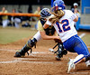(Casey Brooke Lawson / Gator Country) UF Megan Bush slides into home base during University of Florida's game against Georgia Tech.The Gators defeated the Yellow jackets in six innings, 11 to 1, on Sunday, February 15, 2009 during the Lipton Softball Invitational championship at Katie Seashole Pressly Stadium.
