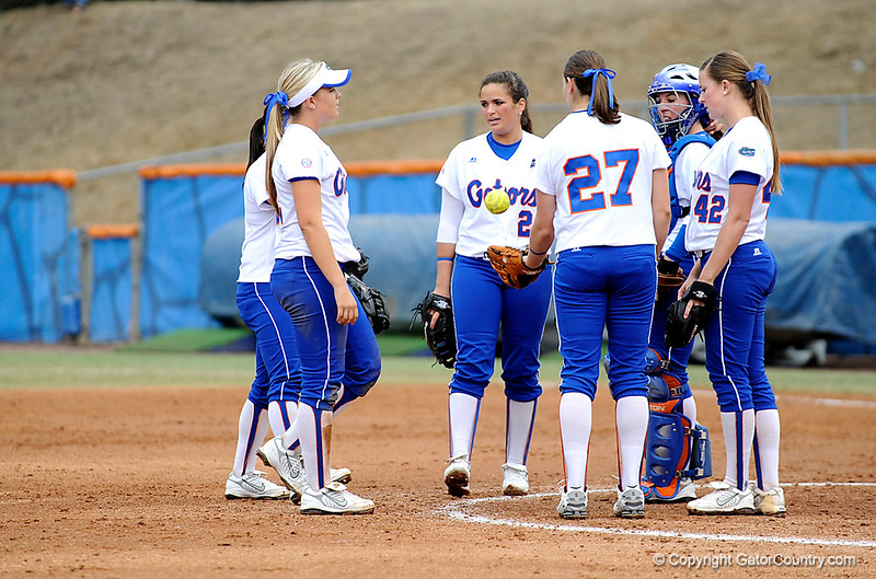 (Casey Brooke Lawson / Gator Country) The UF softball team huddles during University of Florida's game against Georgia Tech. The Gators defeated the Yellow jackets in six innings, 11 to 1, on Sunday, February 15, 2009 during the Lipton Softball Invitational championship at Katie Seashole Pressly Stadium.
