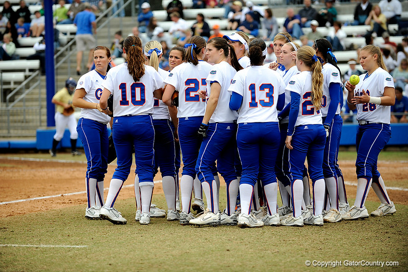 (Casey Brooke Lawson / Gator Country) The UF team huddles during University of Florida's game against Georgia Tech. The Gators defeated the Yellow jackets in six innings, 11 to 1, on Sunday, February 15, 2009 during the Lipton Softball Invitational championship at Katie Seashole Pressly Stadium.
