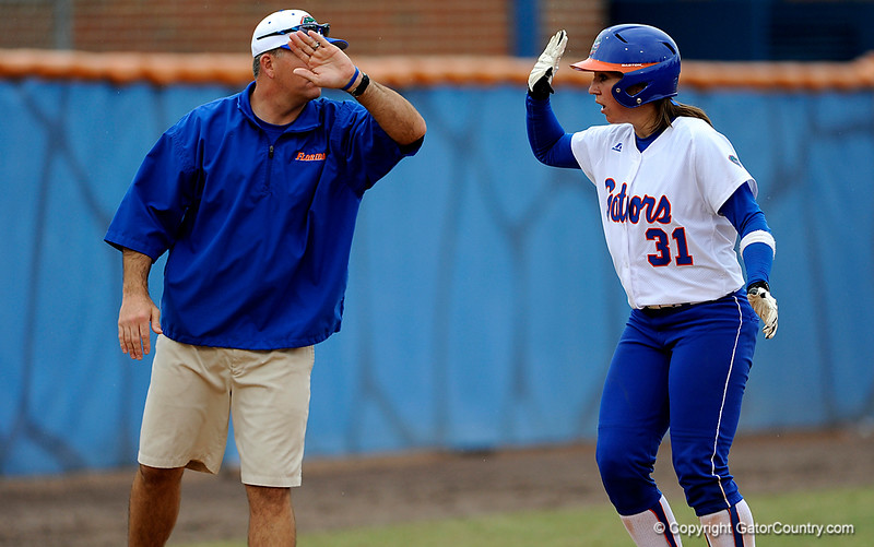 (Casey Brooke Lawson / Gator Country) Kristina Hilberth high-fives her coach in celebration during University of Florida's game against Georgia Tech. The Gators defeated the Yellow jackets in six innings, 11 to 1, on Sunday, February 15, 2009 during the Lipton Softball Invitational championship at Katie Seashole Pressly Stadium.