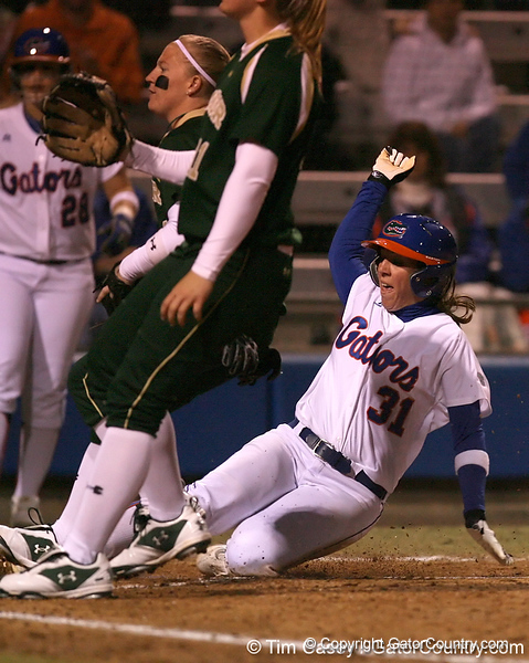 photo by Tim Casey<br /> <br /> Florida senior Kristina Hilberth scores on a passed ball in the third inning during the Gators' 3-0 win against the Baylor Bears on Friday, February 6, 2009 at Katie Seashole Pressly Softball Stadium in Gainesville, Fla.