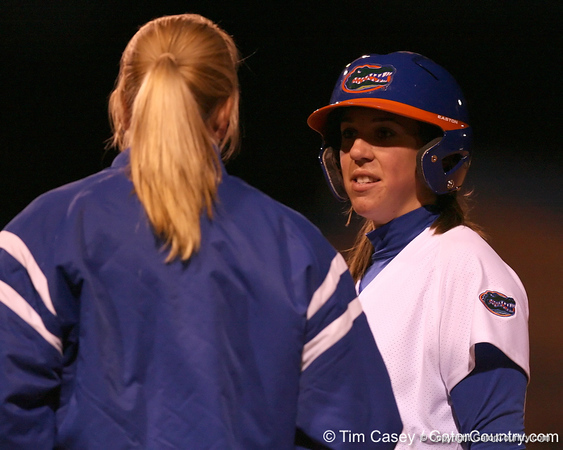photo by Tim Casey<br /> <br /> Florida senior Kristina Hilberth talks with assistant coach Jenny Gladding in the third inning during the Gators' 3-0 win against the Baylor Bears on Friday, February 6, 2009 at Katie Seashole Pressly Softball Stadium in Gainesville, Fla.