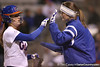 photo by Tim Casey<br /> <br /> Florida student coach Mary Ratliff congratulates Kelsey Bruder after a hit in the sixth inning during the Gators' 3-0 win against the Baylor Bears on Friday, February 6, 2009 at Katie Seashole Pressly Softball Stadium in Gainesville, Fla.