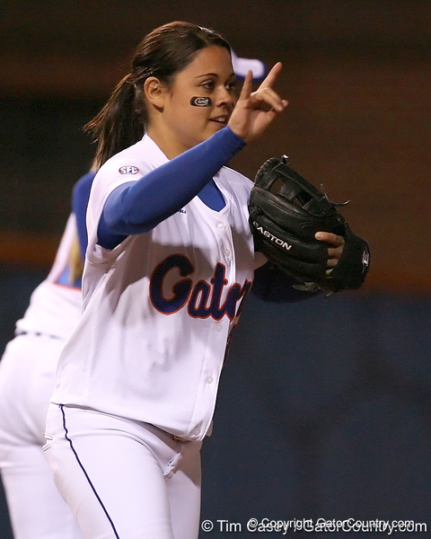 photo by Tim Casey<br /> <br /> Florida sophomore Aja Paculba signals to teammates in the third inning during the Gators' 3-0 win against the Baylor Bears on Friday, February 6, 2009 at Katie Seashole Pressly Softball Stadium in Gainesville, Fla.