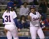 photo by Tim Casey<br /> <br /> Florida sophomore Tiffany DeFelice points to Kristina Hilberth in the fourth inning during the Gators' 3-0 win against the Baylor Bears on Friday, February 6, 2009 at Katie Seashole Pressly Softball Stadium in Gainesville, Fla.
