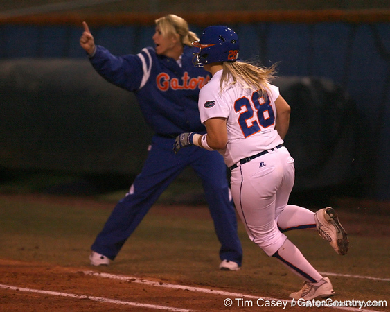 photo by Tim Casey<br /> <br /> Florida sophomore Tiffany DeFelice rounds first base in the second inning during the Gators' 3-0 win against the Baylor Bears on Friday, February 6, 2009 at Katie Seashole Pressly Softball Stadium in Gainesville, Fla.