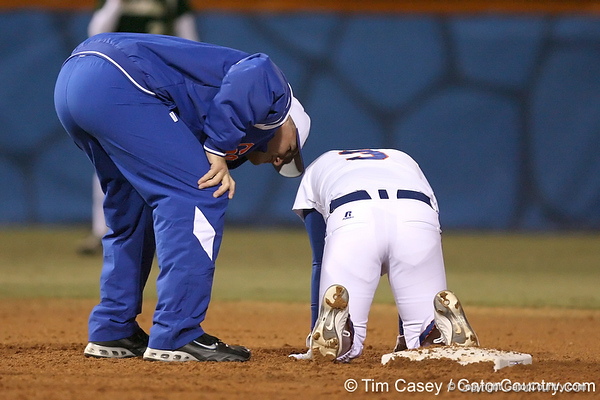 photo by Tim Casey<br /> <br /> Florida coach Tim Walton checks on Aja Paculba in the third inning during the Gators' 3-0 win against the Baylor Bears on Friday, February 6, 2009 at Katie Seashole Pressly Softball Stadium in Gainesville, Fla.