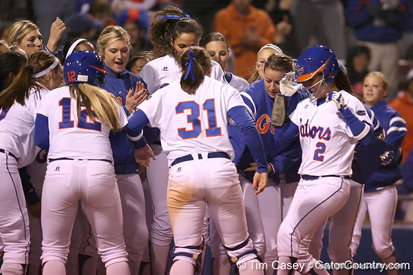 photo by Tim Casey<br /> <br /> Florida sophomore Kelsey Bruder crosses home plate after hitting a home run during the fourth inning of the Gators' 3-0 win against the Baylor Bears on Friday, February 6, 2009 at Katie Seashole Pressly Softball Stadium in Gainesville, Fla.