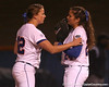 photo by Tim Casey<br /> <br /> Florida seniors Stacey Nelson and Ali Gardiner talk during the seventh inning of the Gators' 3-0 win against the Baylor Bears on Friday, February 6, 2009 at Katie Seashole Pressly Softball Stadium in Gainesville, Fla.